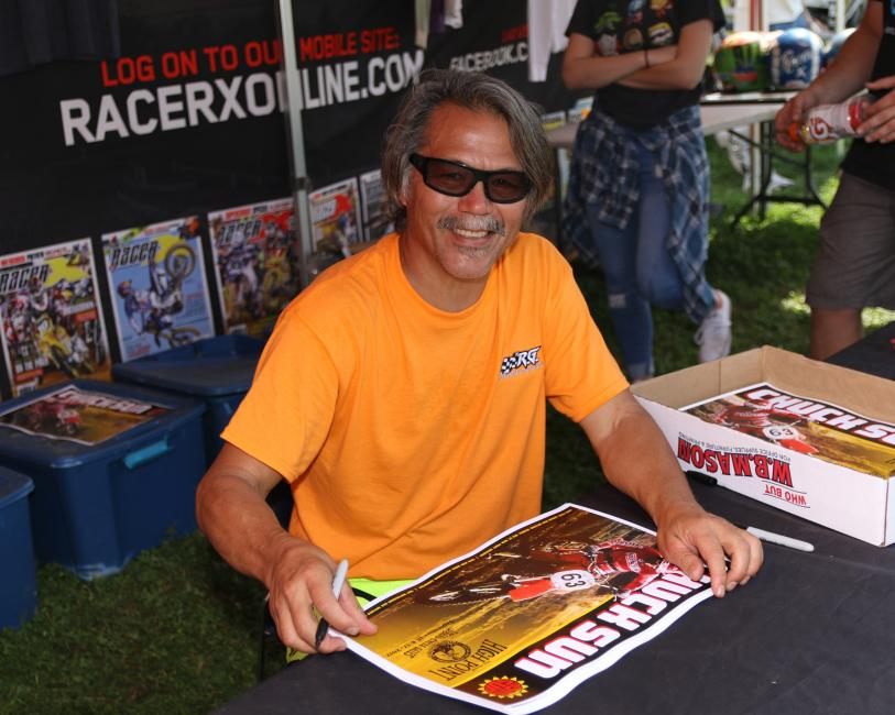 Chuck Sun signing autographs and bench racing at the Racer X booth last year.